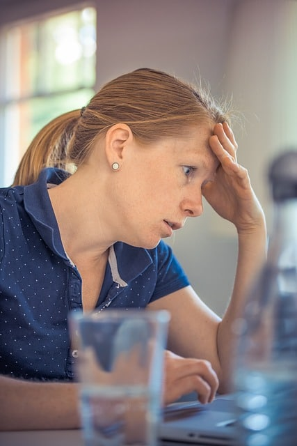 Stress-out adult working on a computer.