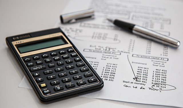 Calculator with a chart of investment accounts.