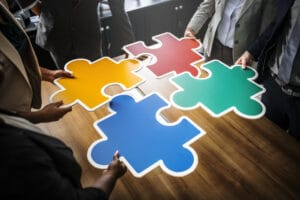 Business team holding puzzle pieces